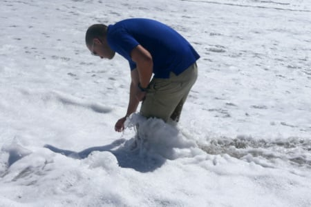 Dr. Justin Perrault, director of research at Loggerhead Marinelife Center, taking a water sample at Juno Beach, FL.