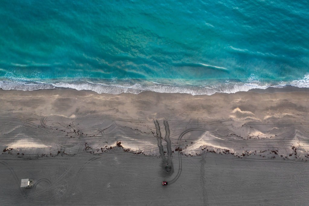 A drone shot of Loggerhead Marinelife Center's research team documenting a newly laid sea turtle nest.