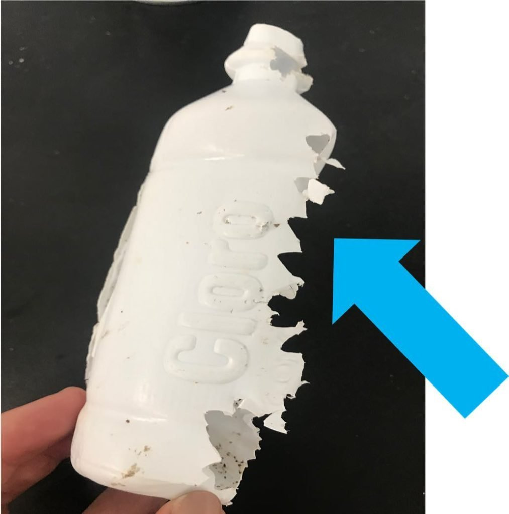 A main problem with plastic pollution is that marine life mistake plastic for food, bite into the plastic, and ingest it. Photo of a piece of plastic with sea turtle bite marks.