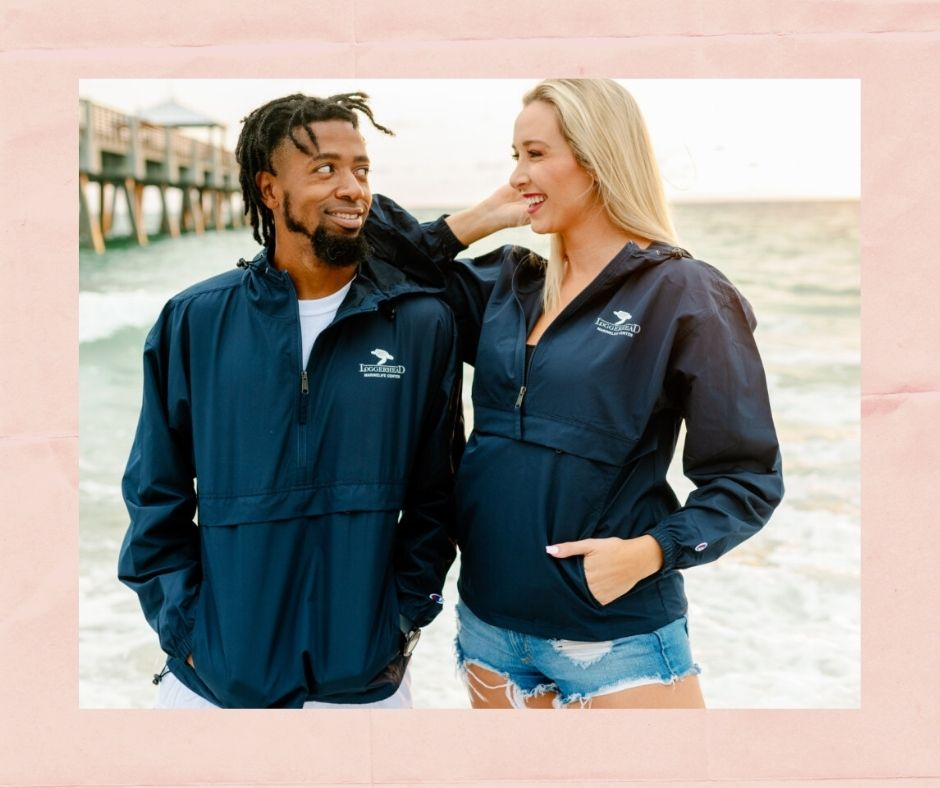Loggerhead Marinelife Center's packable navy jacket featuring LMC's logo makes a great gift for a loved one.