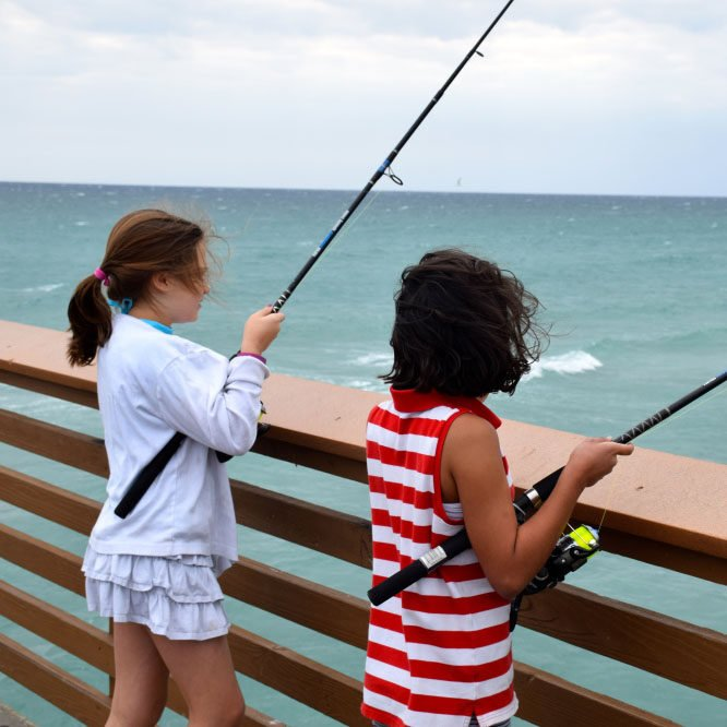 two-anglers-fishing-on-the-juno-beach-pier-during-kids-fishing-program-square